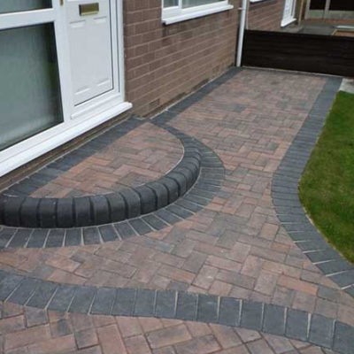 Monoblock front door step and driveway in Harvest Colour with charcoal edge